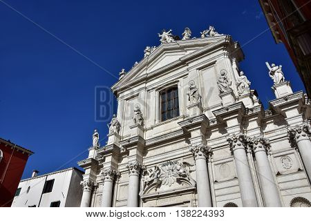 Beautiful baroque facade with saints and apostles of Santa Maria Assunta jesuit church in Venice (18th century)