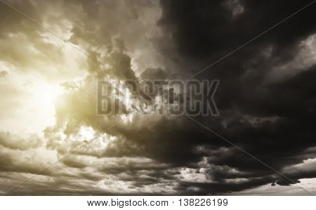 Brown sky with white and black clouds