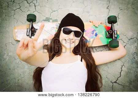 Skater girl doing peace sign gesture