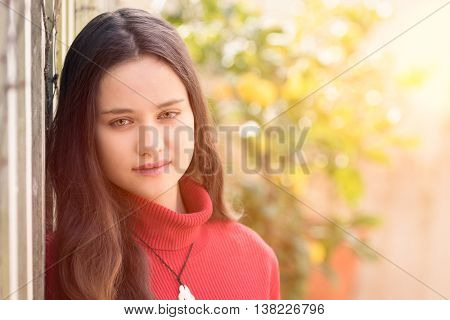 Beautiful teenage girl wearing red sweater