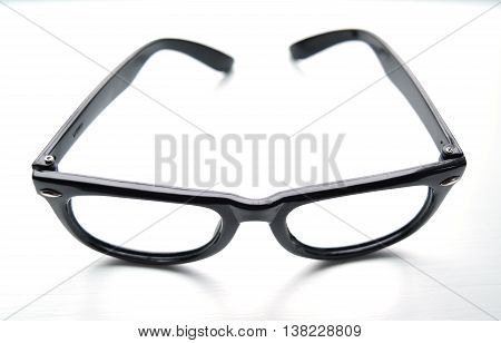 Black plastic glasses with no lenses isolated