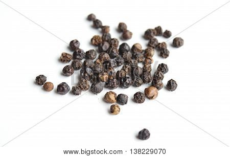 Black peppercorns macro isolated on white background, food and spices