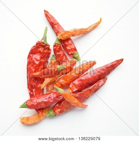 Dried red cayenne chili peppers - isolated