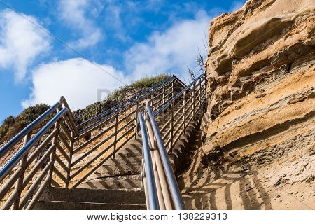 Beach access staircase, view looking up with cliff, Ladera Street, Sunset Cliffs, San Diego, California.