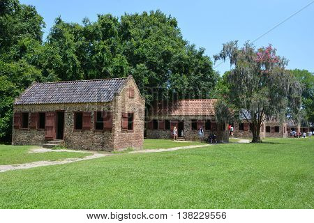 CHARLESTON SOUTH CAROLINA JUNE 28 2016: Slave cabins in Boone Hall Plantation in Mount Pleasant, the slave houses are insightful, and the Gullah Culture explanation is informative