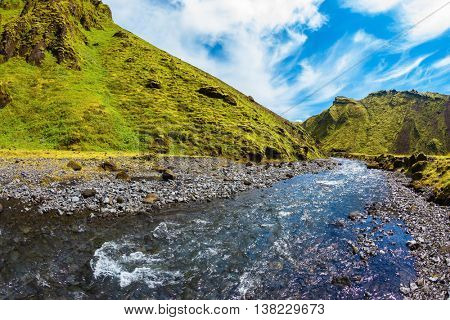 The canyon Pakgil fast flowing shallow stream. Scenic summer Iceland. The photo was taken Fisheye lens