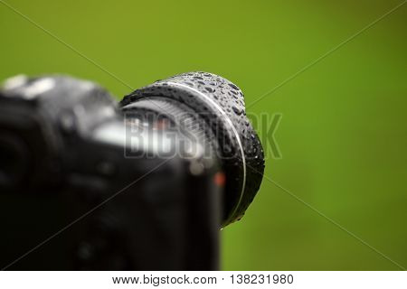 professional digital photo camera in the rain
