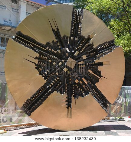 CHARLOTTE NC USA JUNE 20 2016: Il Grando Disco (also known as The Grand Disc) is a round coin-shaped piece of art that sits at Bank of America Plaza was created by Italian sculptor Arnaldo Pomodoro