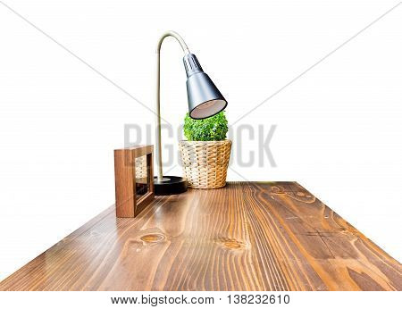 Wood Table Top With Lamp ,picture Frame And Green Bush In Wicker Basket Isolate On White Background,