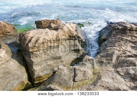 Closeup of the natural coastal limestone formation with the Indian Ocean waters on the coast line at Penguin Island in Rockingham, Western Australia.
