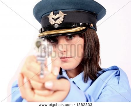 Beautiful Brunette Female Police Officer Pointing A Gun