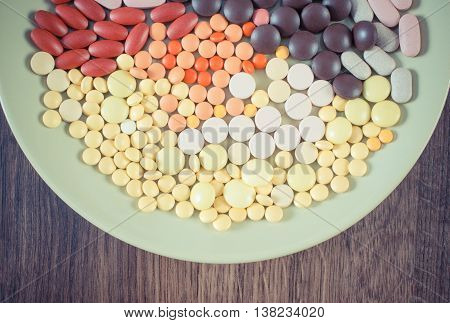 Vintage Photo, Colorful Medical Pills, Tablets And Capsules On Plate, Health Care Concept