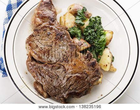 Rib Eye steak with potatoes and spinach
