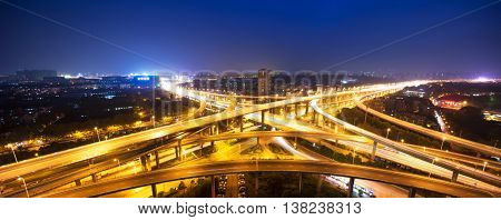 busy traffic on road junction in downtown of hangzhou at night