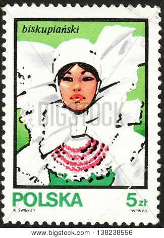 MOSCOW RUSSIA - DECEMBER 2015: a post stamp printed in POLAND shows a woman in the national dress of Biskupianski the series