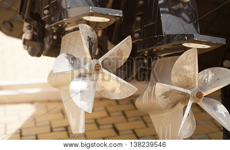 Used dirty Motorboat engine closeup.view of the propellers.