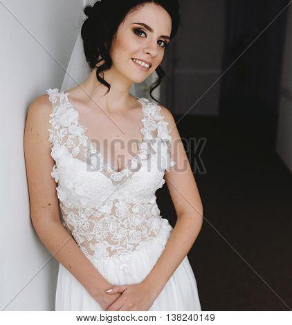 Bride posing in a corridor on the camera