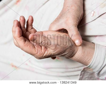 Old Woman Measuring Her Pulse