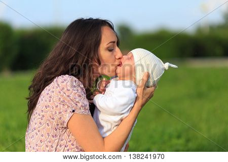 Mother soothing crying baby in her arms