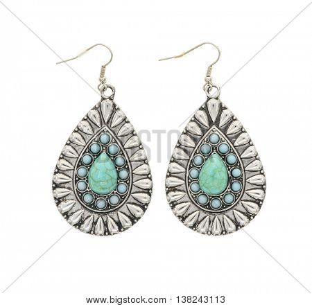 silver earrings with green stones isolated on white