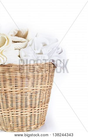 the white towel and cloth wicker baskets on white background