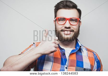happy man giving thumbs up sign
