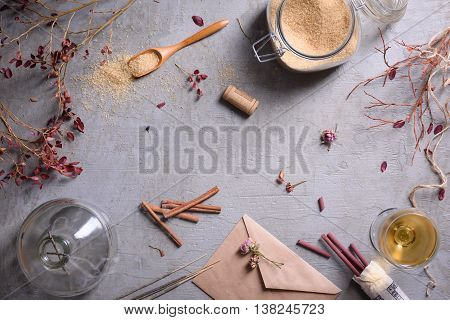 Ingredients for sweet preserves: sugar, cinnamon, white wine on grey surface. Autumn mood background. Copy space, top view.