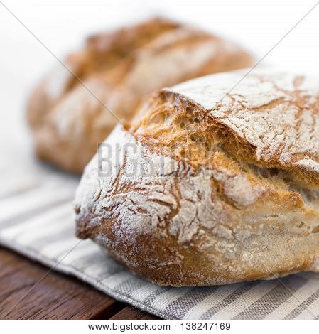 Extreme clos-up of rustic Italian bread isolated on background out of focus.