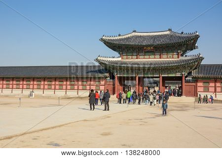 SEOUL SOUTH KOREA - OCTOBER 3 2014 : Tourists visited Gyeongbokgung palace the largest palace and famous landmark of Seoul South Korea