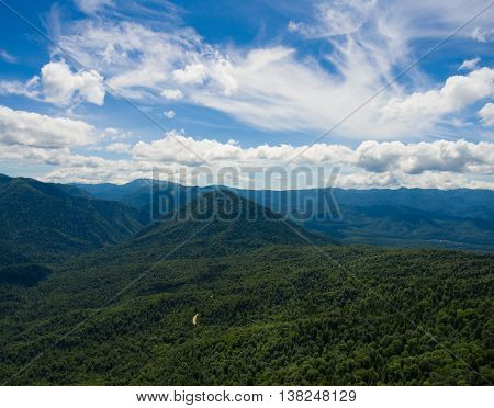 Aerial Photo. Mountain Valley. Summer Landscape With Mountain Peaks Covered With Forest And A Cloudy