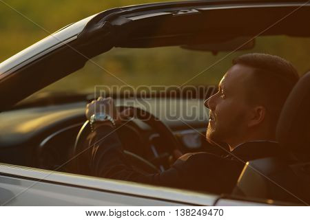 Portrait of a businessman, Businessman by car, portrait of a man, driving a convertible