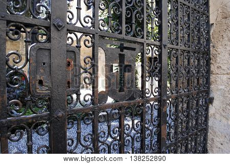 the old wrought-iron gate with rust in the fortress of Rhodes