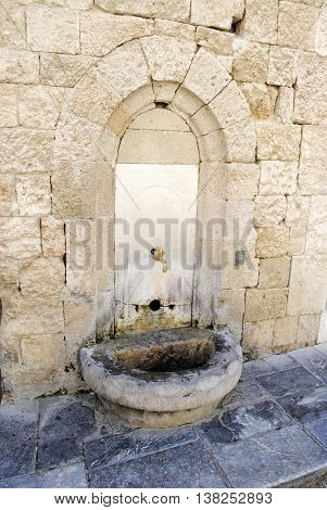 ancient weathered current drinking source in the fortress of Rhodes