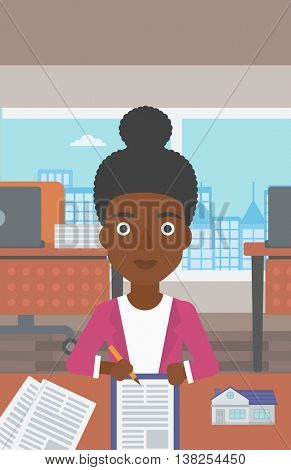 An african-american female real estate agent signing a contract. Real estate agent sitting at workplace in office with a house model on the table. Vector flat design illustration. Vertical layout.