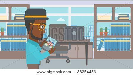 An african-american man looking at house on a digital tablet screen. Young man standing in office and looking for house on tablet computer. Vector flat design illustration. Horizontal layout.