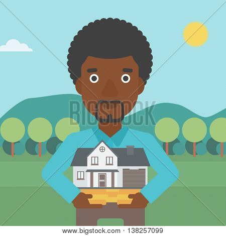 An african-american man holding house model in hands on the background of mountains. Real estate agent with house model. Vector flat design illustration. Square layout.