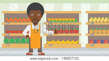 An african-american male supermarket worker showing thumb up on the background of shelves with vegetables and fruits in supermarket. Vector flat design illustration. Horizontal layout.