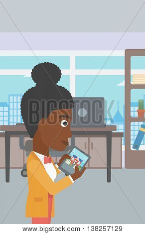 An african-american woman looking at house on a digital tablet screen. Young woman standing in office and looking for house on tablet computer. Vector flat design illustration. Vertical layout.