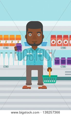 An african-american young man holding shopping basket in one hand and a milk product in the other. Male customer shopping at supermarket with basket. Vector flat design illustration. Vertical layout.
