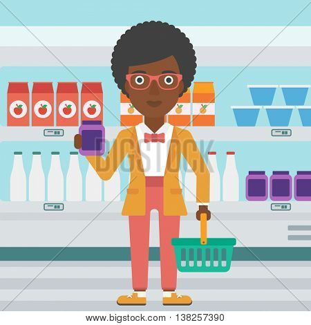 An african-american woman holding shopping basket in one hand and milk product in the other. Female customer shopping at supermarket with basket. Vector flat design illustration. Square layout.