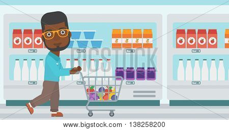 An african-american young man pushing a supermarket cart with some goods in it. Customer shopping at supermarket with cart. Vector flat design illustration. Horizontal layout.