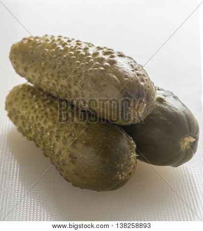 Pickled Cucumbers gherkins on a white background