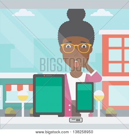 Astonished woman looking at digital tablet and smartphone through shop window. An african-american woman with open mouth looking at tablet and phone. Vector flat design illustration. Square layout.