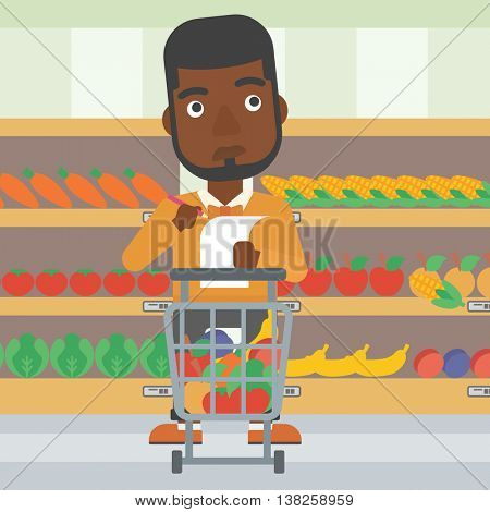 An african-american thoughtful man standing at the supermarket with supermarket trolley full with products and holding a shopping list in hands. Vector flat design illustration. Square layout.