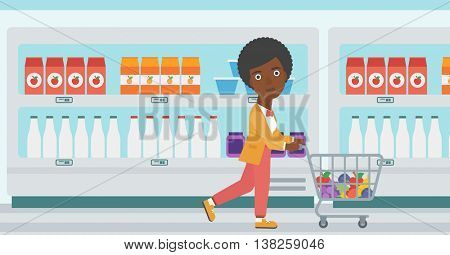An african-american young woman pushing a supermarket cart with some goods in it. Customer shopping at supermarket with cart full with groceries. Vector flat design illustration. Horizontal layout.