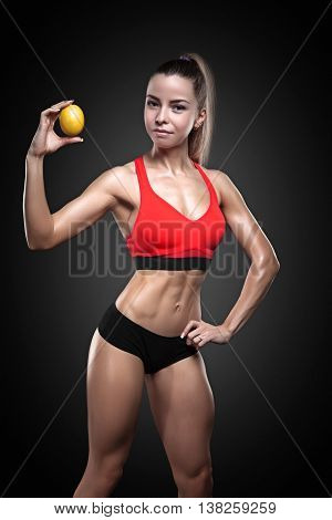 Beautiful sportly fitness woman holding lemon next to their buttocks. Girl's hip and an orange. Anti-cellulite program