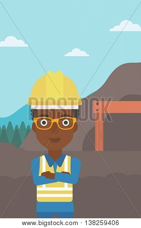 An african-american confident coal miner. Female miner standing in front of a big mining equipment on the background of coal mine. Vector flat design illustration. Vertical layout.