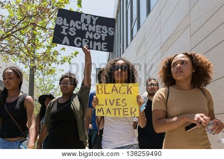 Black Lives Matter Protestors Holding A Poster During March On City Hall