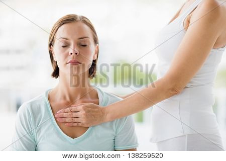 Young woman receiving masaage from masseur