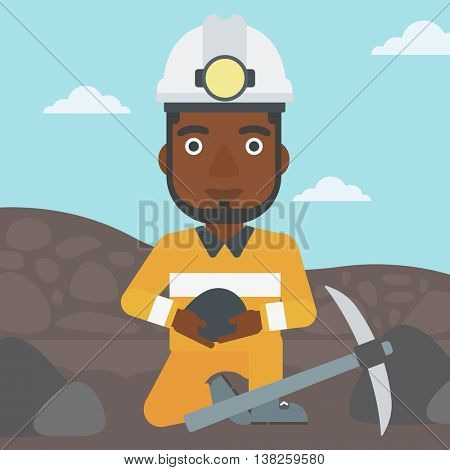 An african-american miner in hard hat sitting with coal in hands and a pickaxe on the background of coal mine. Vector flat design illustration. Square layout.